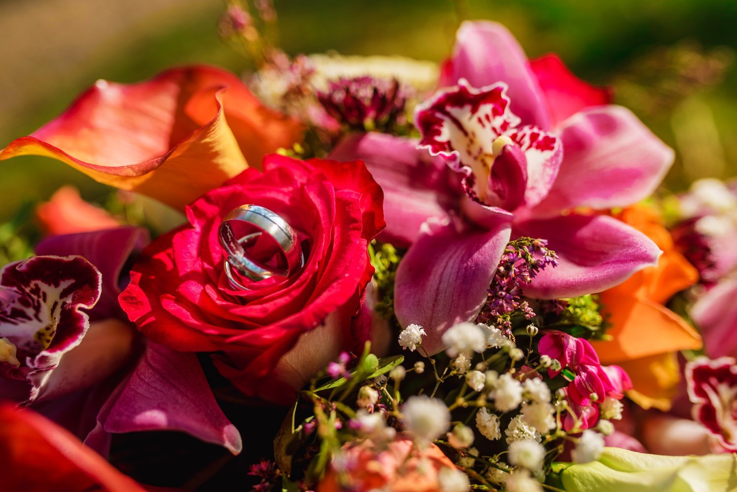 New Place Hotel Wedding - wedding rings photo on the boquet of flowers
