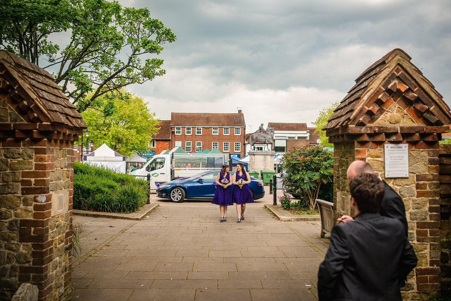 bridesmaids walking up to the church - Petersfield Wedding Photography