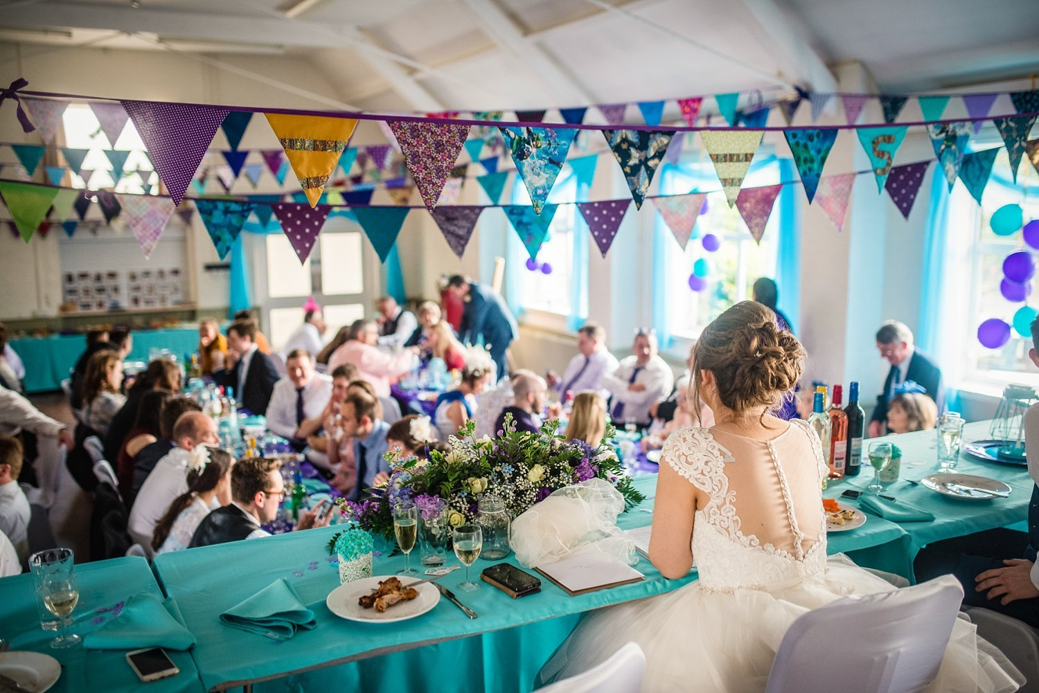 Petersfield Wedding Photography - bride overlooking the wedding party from the top table