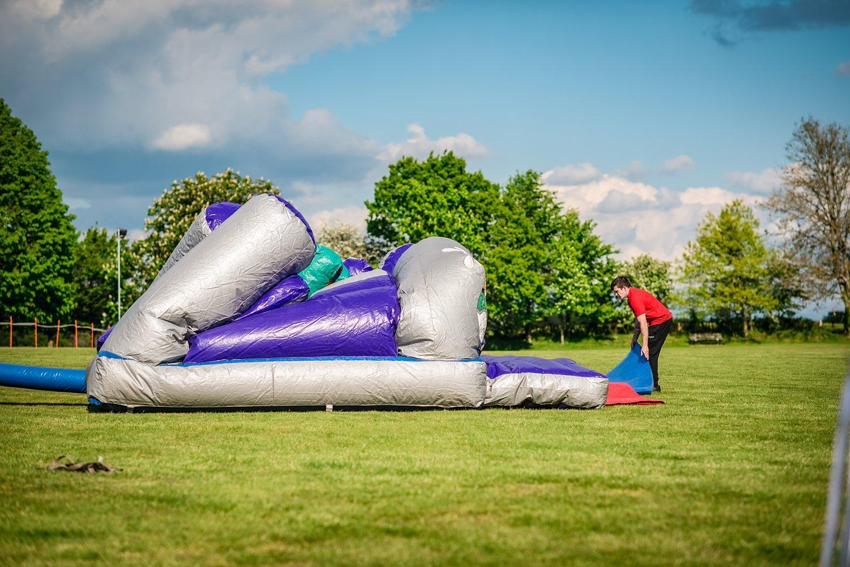 unpacking bouncy castle - Petersfield Wedding Photography