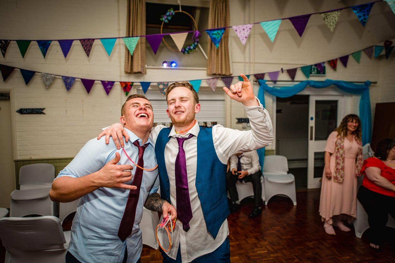 2 men are dancing - Petersfield Wedding Photographer
