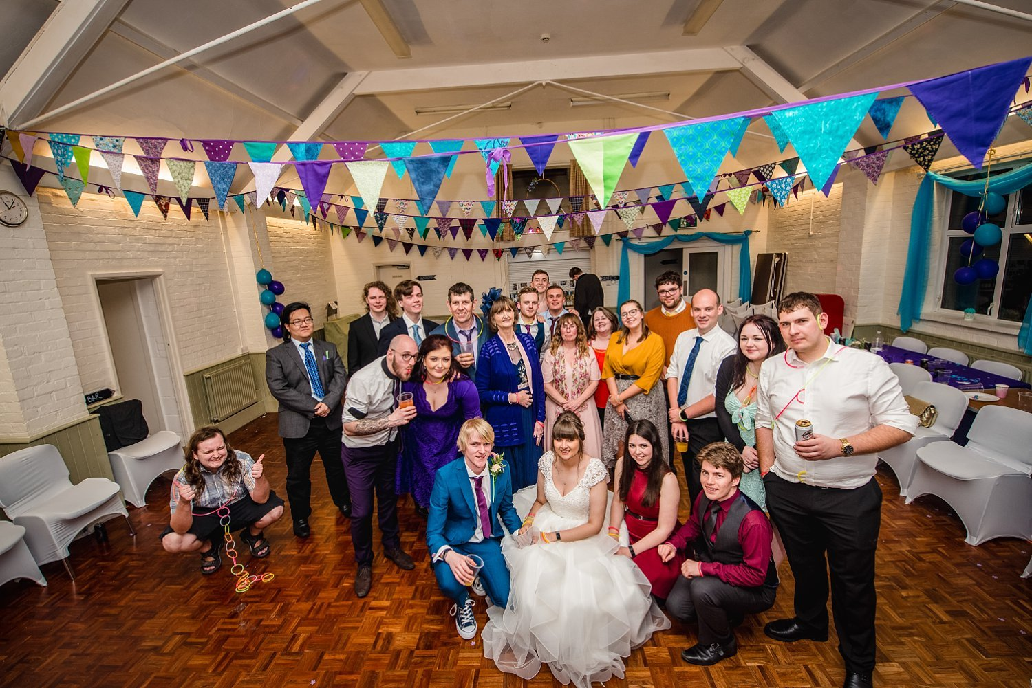 one of the last photos from the wedding day. big group photo on the dancefloor - Petersfield Wedding Photography