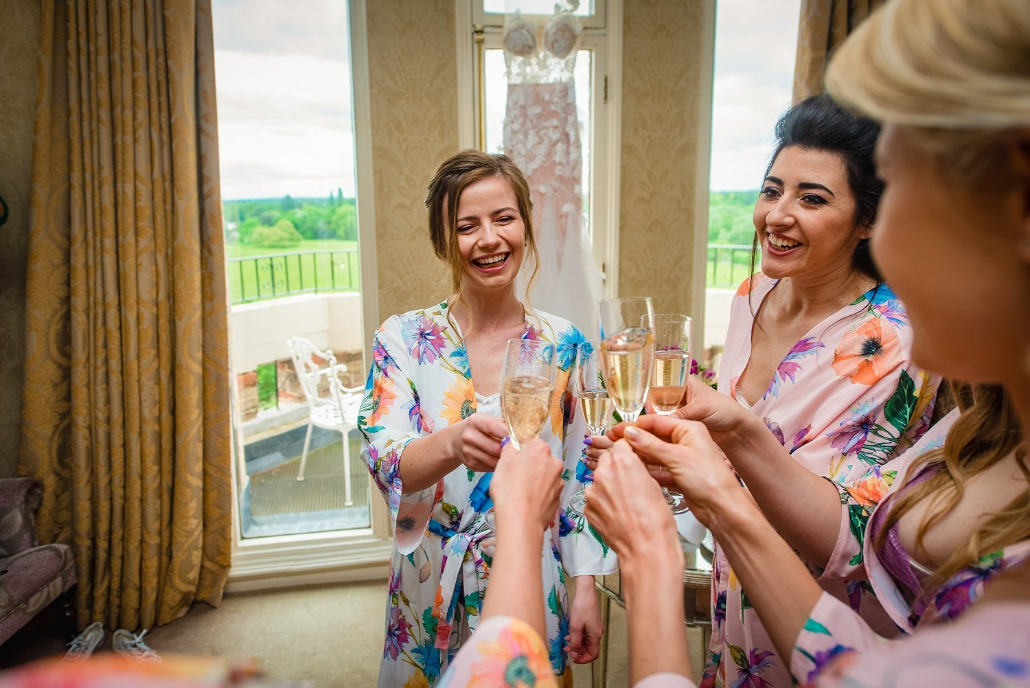 Fun-Filled wedding in Pembroke Lodge - bride is hvaing a toast