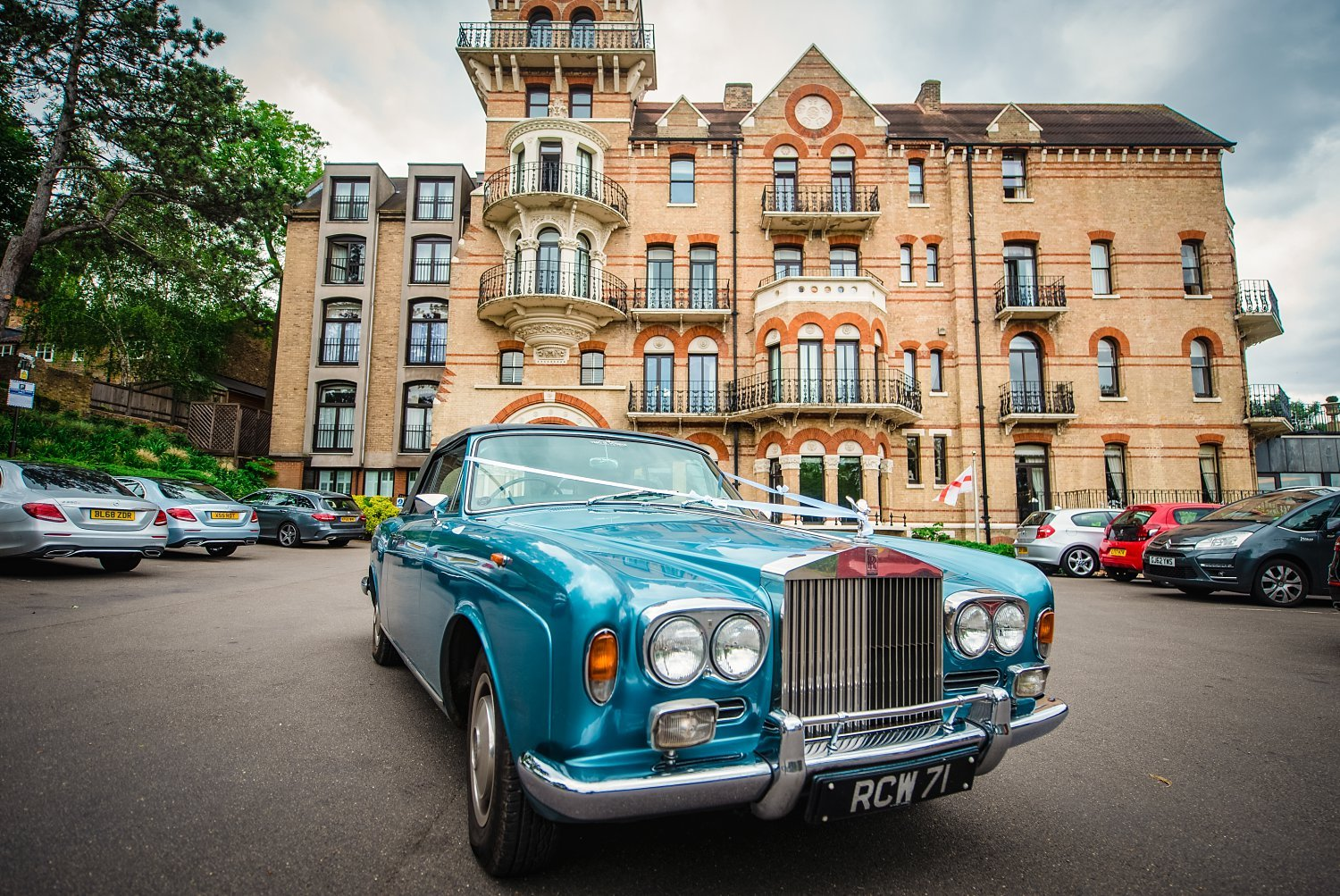 Fun-Filled wedding in Pembroke Lodge - photo of the wedding car, behind you can see the Petersham Hotel