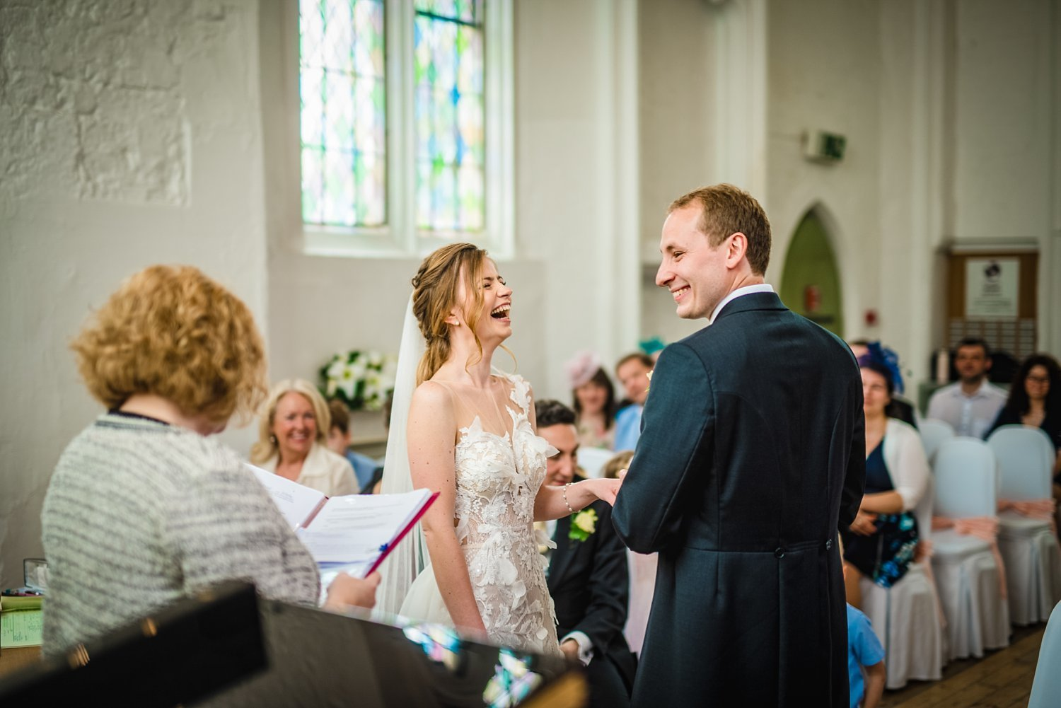 Fun-Filled wedding in Pembroke Lodge - exchange of rings, bride and groom are laughing