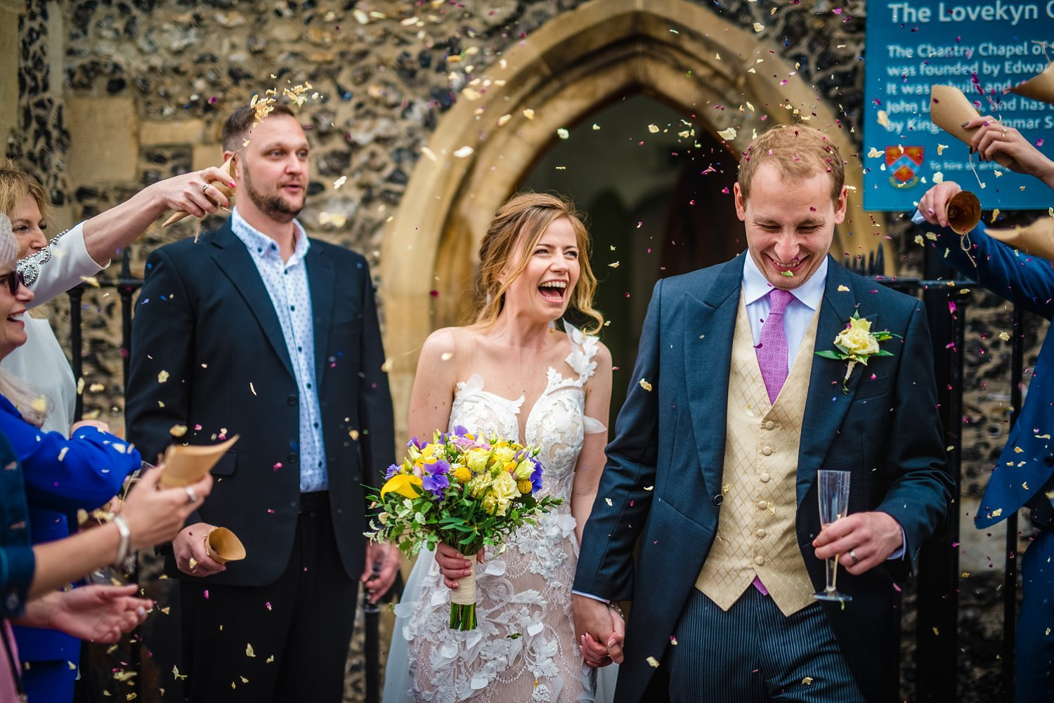 Fun-Filled wedding in Pembroke Lodge - bride and groom are walking while confetti is being thrown