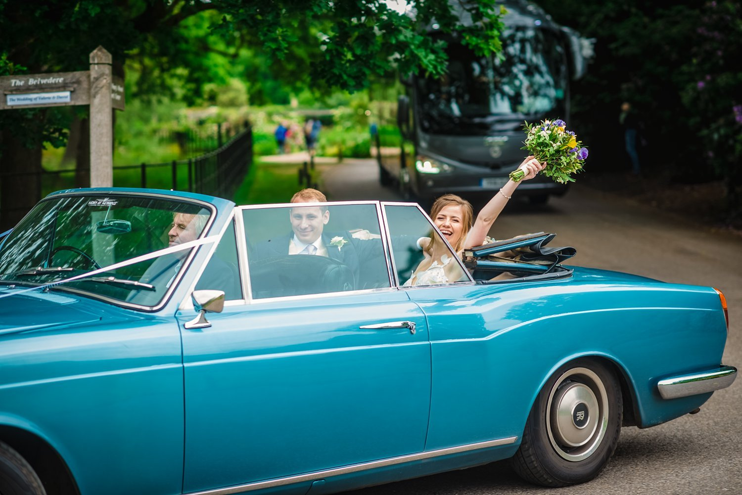 Fun-Filled wedding in Pembroke Lodge - bride and groom in the wedding car. bride is holding a bouqet in the hand,