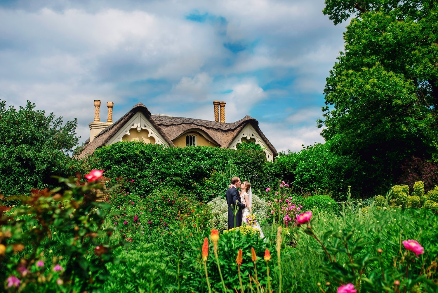 Fun-Filled wedding in Pembroke Lodge - bride and groom having a kiss