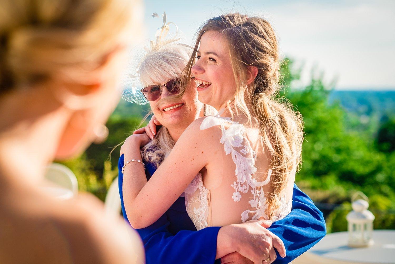 Fun-Filled wedding in Pembroke Lodge - bride is hugging her mum