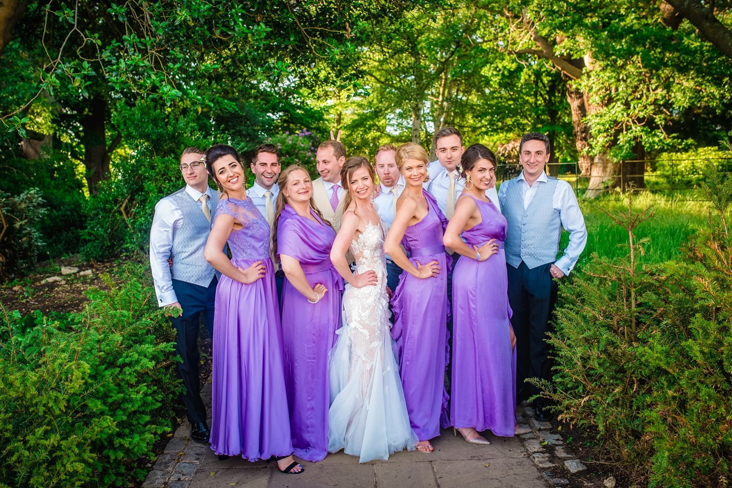 Fun-Filled wedding in Pembroke Lodge - group photo of bride, groom, bridesmaids and groomsmen. they are all smiling