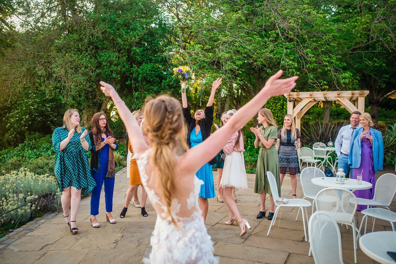 Fun-Filled wedding in Pembroke Lodge - lady caught wedding flowers