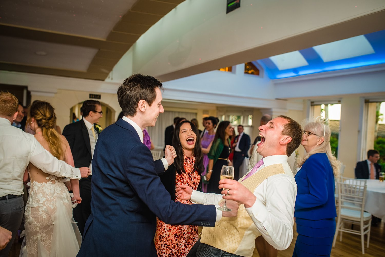 Fun-Filled wedding in Pembroke Lodge - groom is laughing on the dance floor