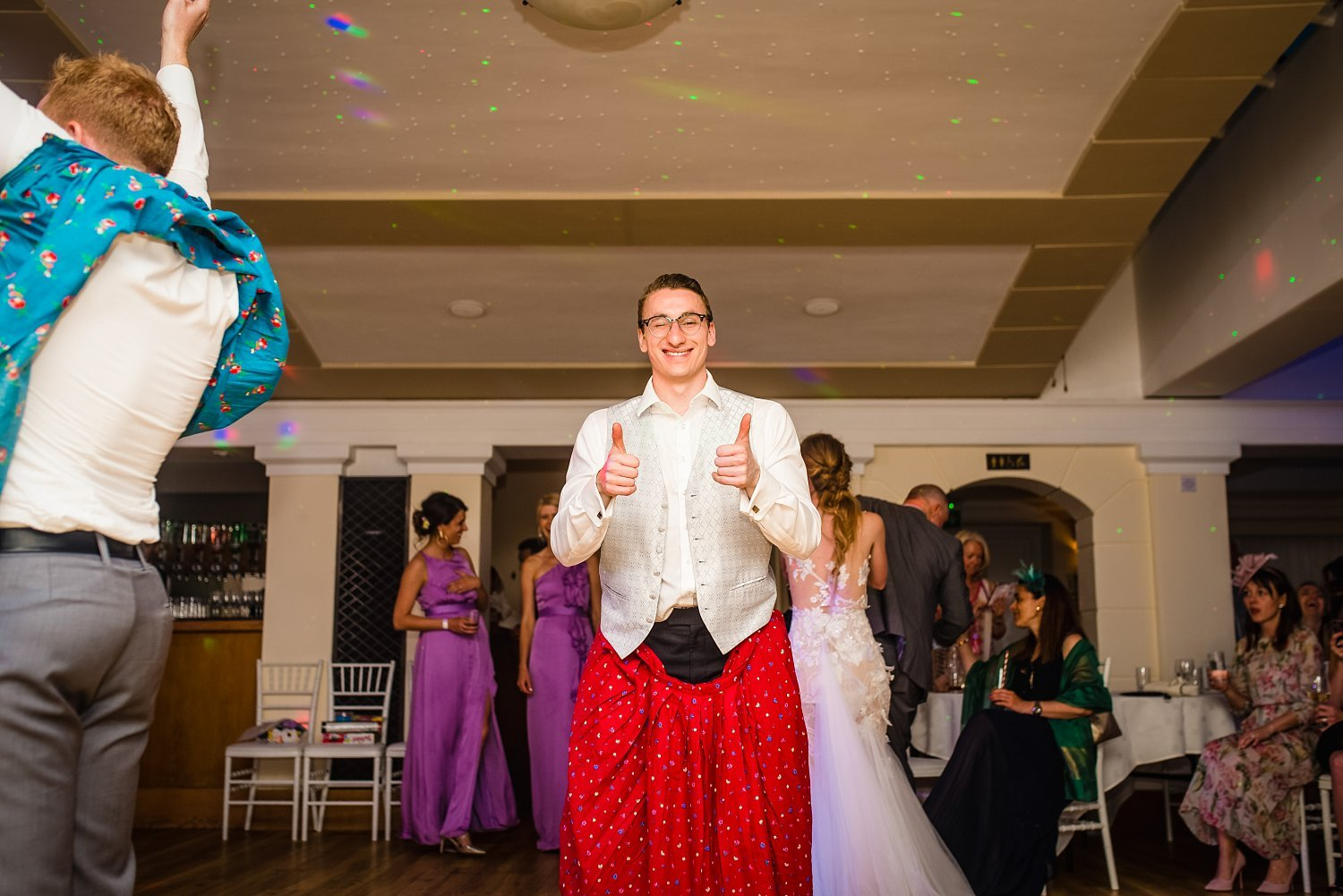 Fun-Filled wedding in Pembroke Lodge - grooms brother is holding thumbs up