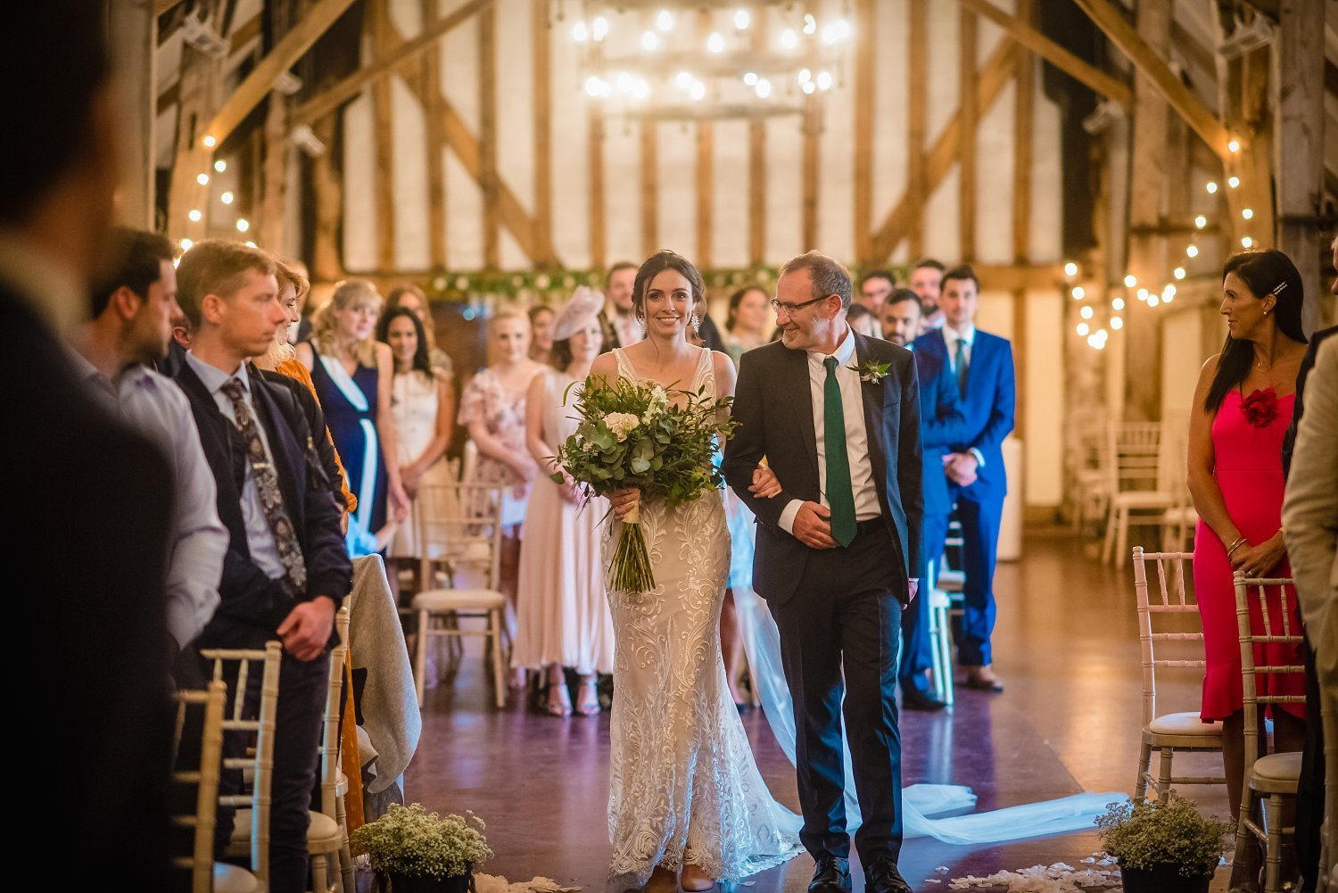 Colville Hall Weding Photographer-bride is walking down the aisle with her dad