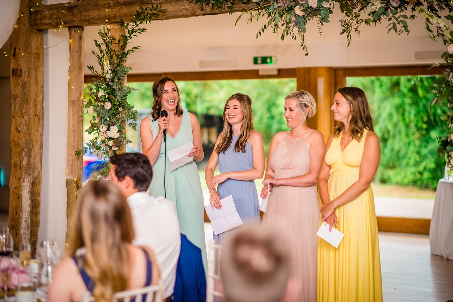 Colville Hall Weding Photographer-bridesmaids are doing a speech