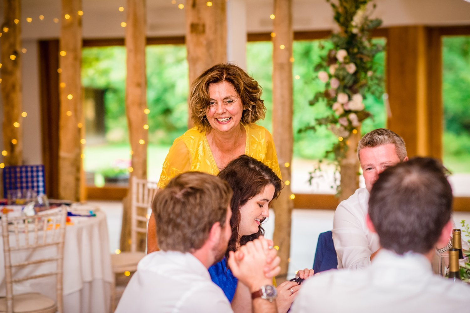 Colville Hall Weding Photographer-mother of the bride is laughing