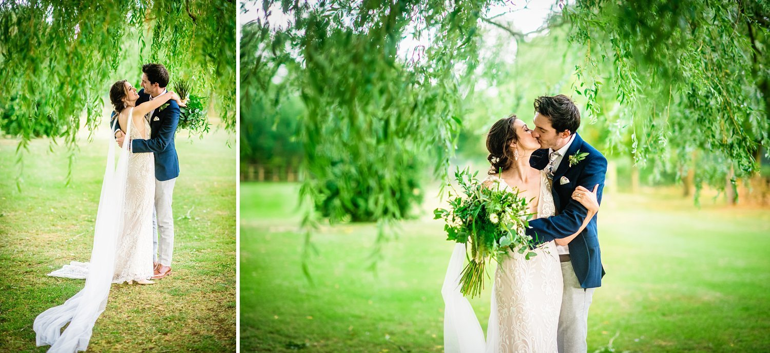 Colville Hall Weding Photographer-bride and groom are having a kiss under a willow tree