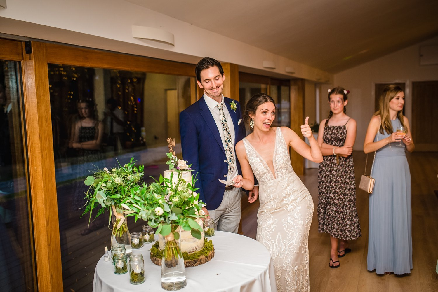 Colville Hall Weding Photographer - bride with her thumbs up. groom is standing next to her