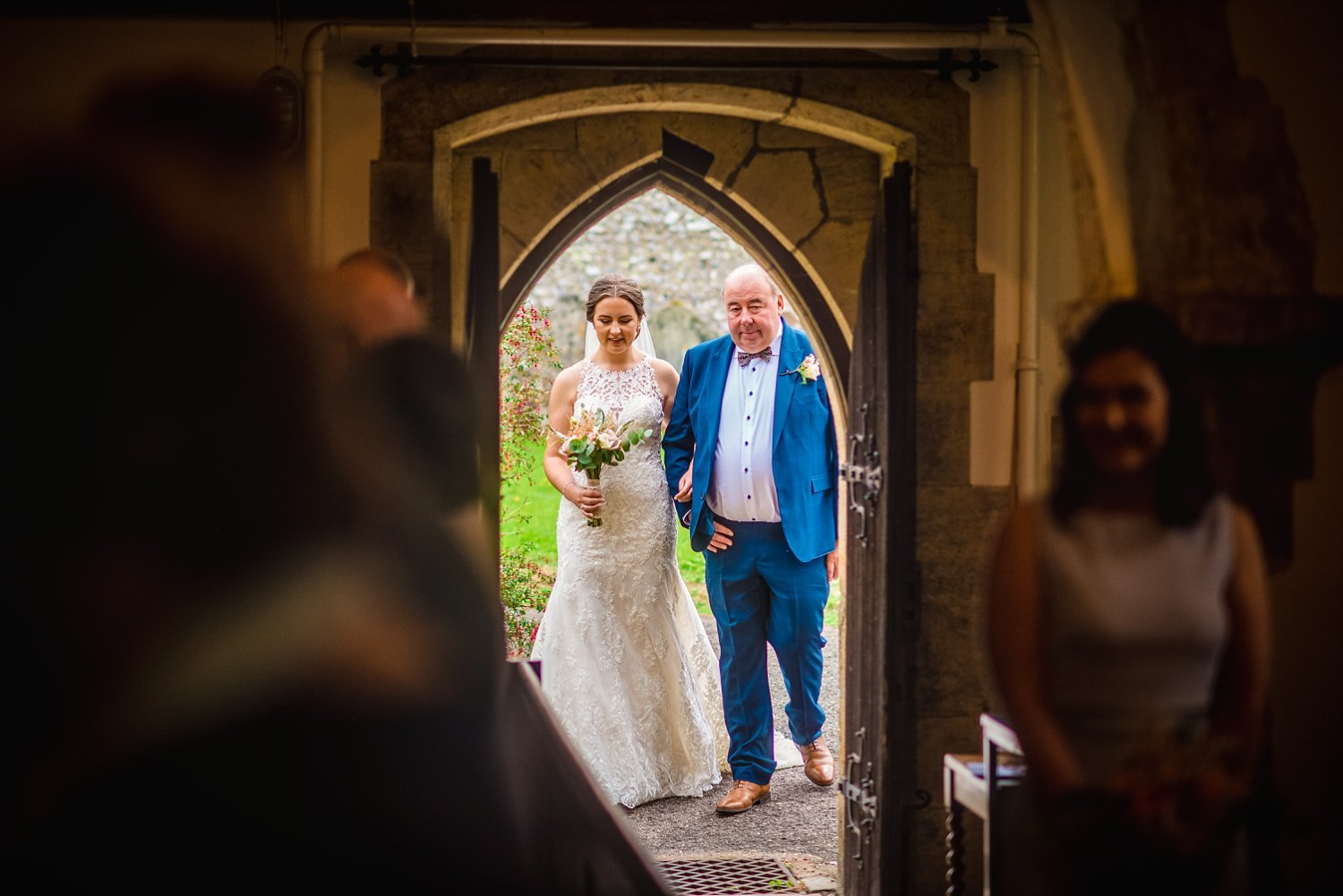 Duncton Mill Fishery Wedding - bride and her dad are entering the church
