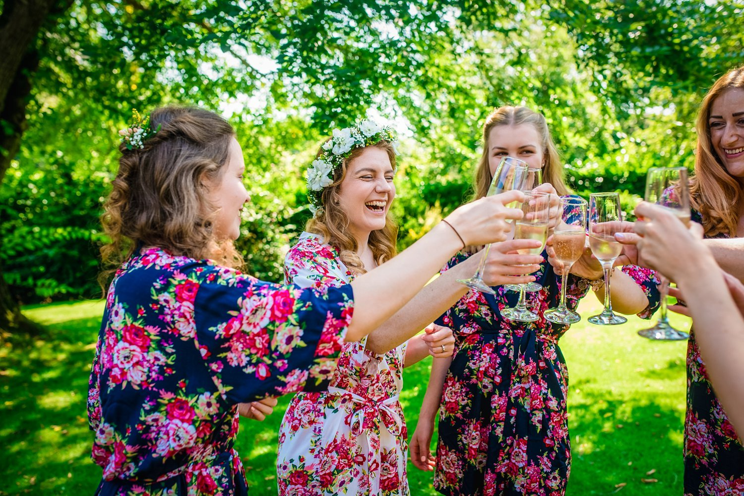 Farnham Wedding Photographer - bride is having a toast with her bridesmaids