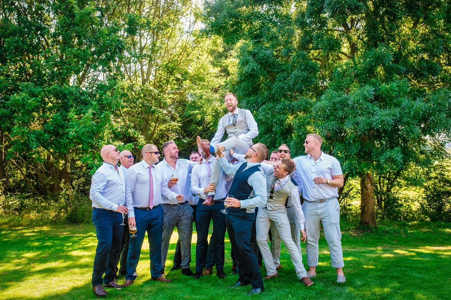Farnham Wedding Photographer - boys lifted groom up. groom is laughing