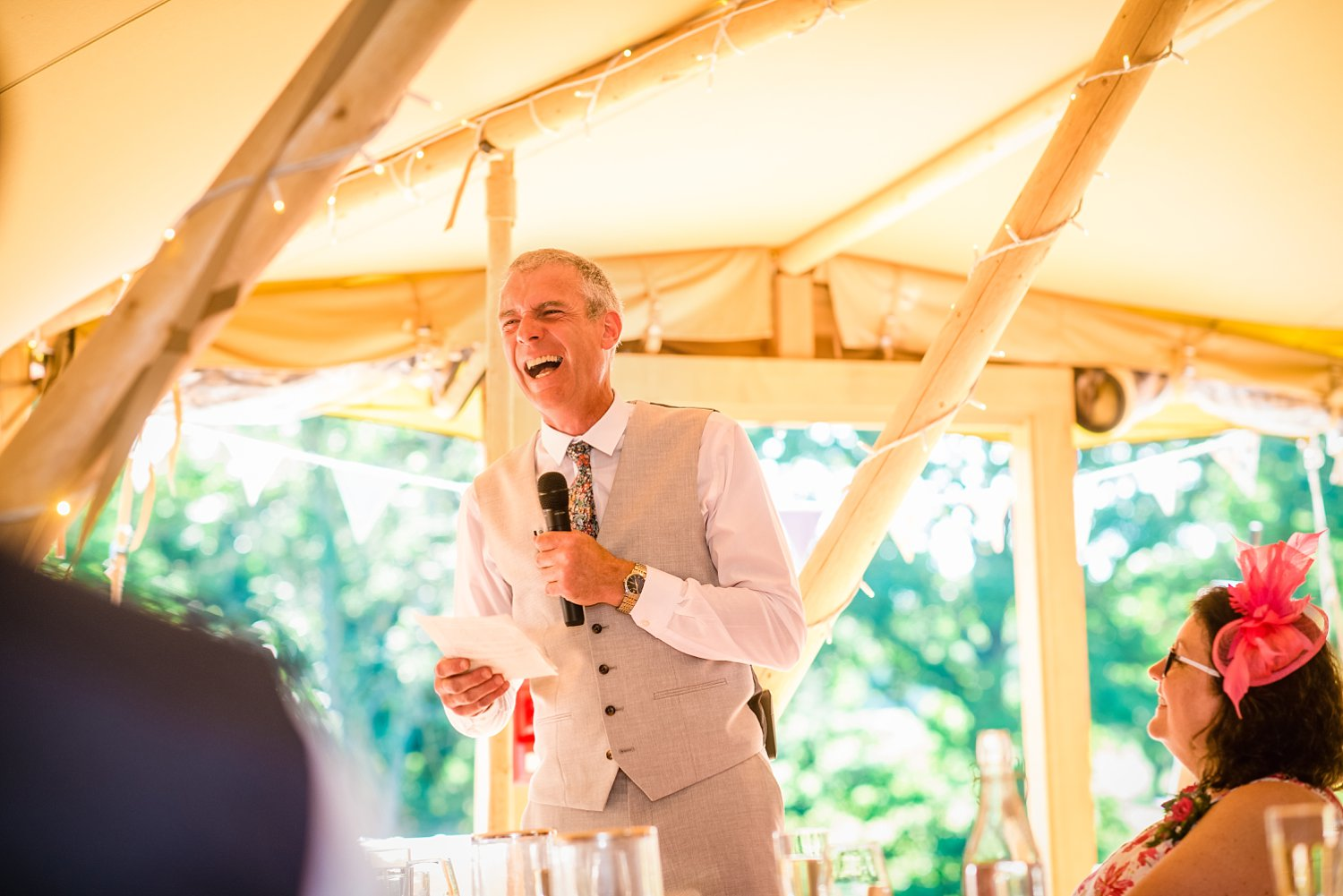 Farnham Wedding Photographer - father of the bride is laughing during his speech