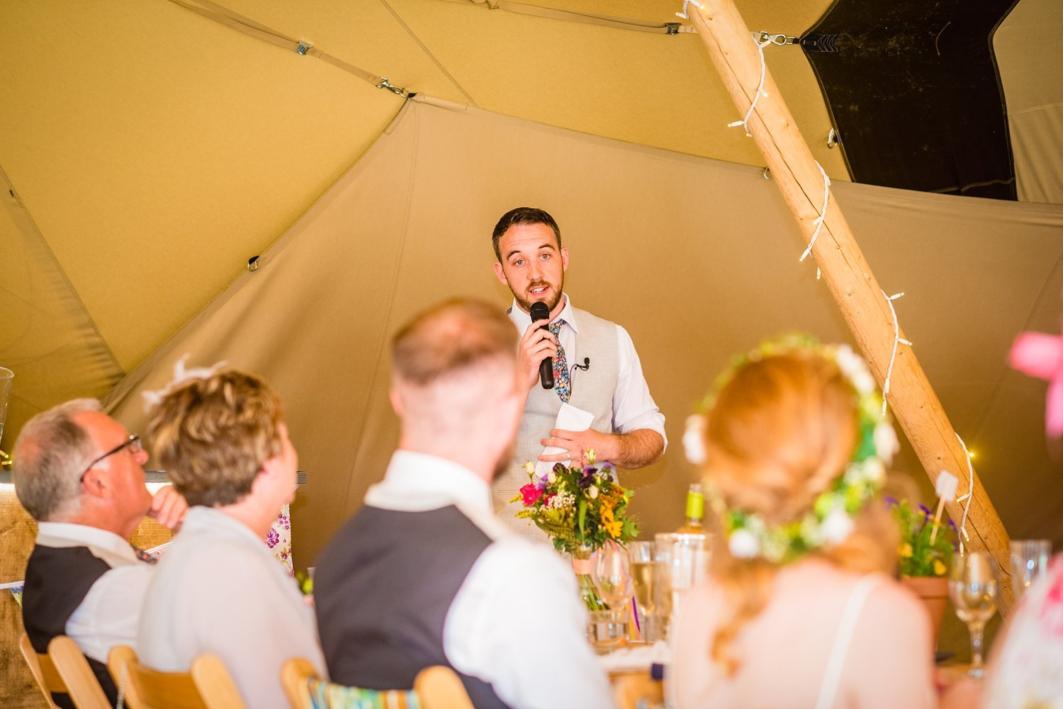Farnham Wedding Photographer - best man's speech, he's looking at bride and groom