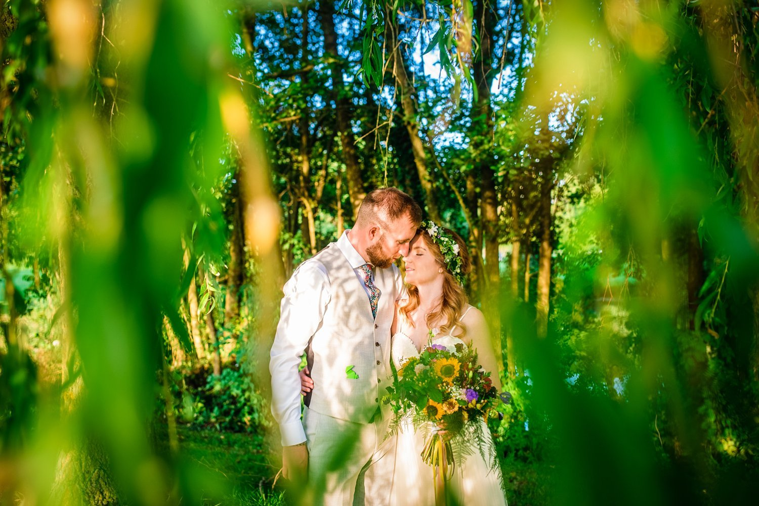 Farnham Wedding Photographer - husband and wife are keeping their heads together