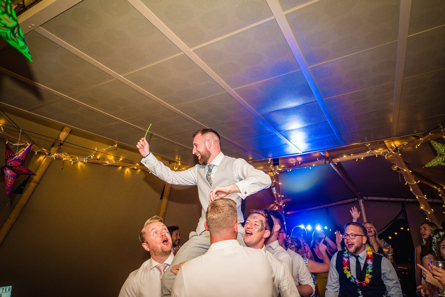 Farnham Wedding Photographer - groom has been lifted by his friends